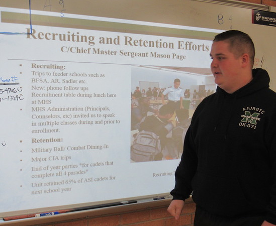 CATHY SPAULDING/Muskogee Phoenix<br /> Muskogee High School Air Force Junior ROTC Cadet Chief Master Sgt. Mason Page explains steps the unit took to recruit and retain cadets. The unit went from 55 cadets in February to 105 in October.