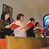 Staff photo by Cathy Spaulding<br /> Worshippers, from left, Cuc Nguyen, Tri Le, Julie Le, Hoa Le, Tga Tran and keyboardist Nina Nguyen join in the Vietnamese service at St. Joseph Catholic Church. The hymns are sung in Vietnamese.