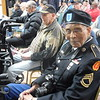 KENTON BROOKS/Muskogee Phoenix<br /> Herman Kirby of Muskogee waits for the ceremony to honor Muskogee Veterans to begin at Arrowhead Mall on Saturday. The 91-year-old Muskogee resident, who fought in the Korean and Vietnam Wars, was among the 116 veterans who received medals during the ceremony.