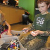 CATHY SPAULDING/Muskogee Phoenix<br /> Lilliana Staggers, 6, left, and Alex Staggers, 9, sort through LEGO blocks during a Homeschool Recess one recent Friday at Muskogee First Assembly of God.