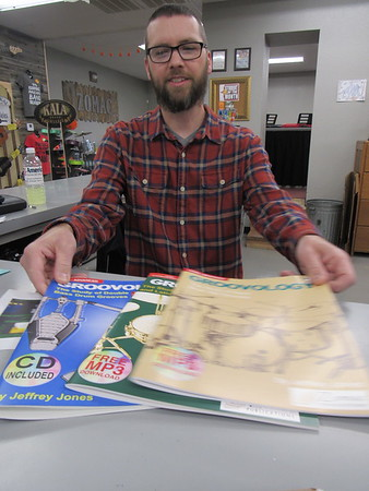 CATHY SPAULDING/Muskogee Phoenix<br /> Jeff Jones shows some of the percussion instruction books he has written. He teaches percussion at Hilldale and Checotah schools, as well as privately.