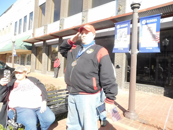 KENTON BROOKS/Muskogee Phoenix<br /> Louie Bono of Wagoner stands at attention and salutes the American flag as it passes by during the Muskogee Veterans Day Parade in downtown Muskogee on Saturday. Bono, who fought in the Vietnam War, was one of 116 veterans recognized with medals during a pre-parade ceremony in Arrowhead Mall.