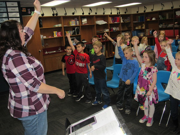 "Early Learning Center music teacher Renee Evans leads first-graders in the ""I'm Thankful"" song, which they will sing Wednesday at a Veterans Day program."