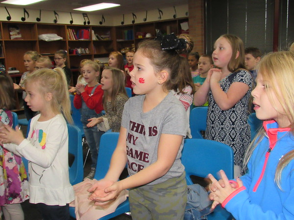 CATHY SPAULDING/Muskogee Phoenix Early Learning Center first-graders, from left, Rihyn Martin, Kayleigh Smith and Teagan Peters practice for the upcoming Veterans Day program. They will join kindergartners and second-graders.
