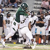 Phoenix special photo by Shane Keeter<br /> Muskogee's Quintevin Cherry, left, bowls over Midwest City's T'aces Vick during the Roughers' 26-20 loss to the Bombers in the first game of the 2017 season. Four of the five Roughers' losses were to the remaining teams in the Class 6AII playoffs.