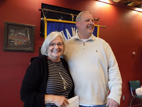 Staff photo by Mike Elswick<br /> Eileen Van Kirk was all smiles as she accepted a donation from Exchange Club of Muskogee President Darrin Smith. She was accepting the contribution on behalf of the Youth Volunteer Corps program.