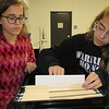 Staff photo by Cathy Spaulding<br /> Haskell High School juniors Sara Dillingham, left, and Tara Dillingham look through the files they use while debating. The two made quarterfinals in the 2016 Oklahoma Secondary Schools Activities Association State Speech Contest.