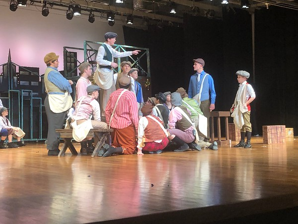"""CHESLEY OXENDINE/Muskogee Phoenix Newsboys gather around Jack Kelley, played by junior Clay Pendergraft, as he talks about organizing a strike in the musical """"Newsies,"""" performed by the Tiger Theatre Company."""