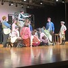 "CHESLEY OXENDINE/Muskogee Phoenix<br /> Newsboys gather around Jack Kelley, played by junior Clay Pendergraft, as he talks about organizing a strike in the musical ""Newsies,"" performed by the Tiger Theatre Company."