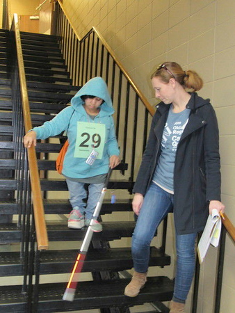 Oklahoma School for the Blind freshman Samantha Six, left, descends stairs at Muskogee Civic Center while orientation and mobility specialist Anna Wallace checks her progress during Oklahoma Regional Cane Quest on Thursday.