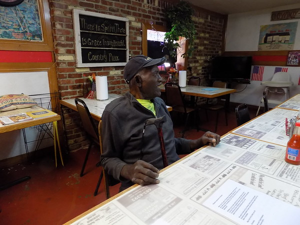 Staff photo by Mike Elswick<br /> Longtime Smokehouse Bob's Barbecue owner Robert Newton is seen inside the eatery's dining room. Newton said he enjoys visiting with customers, many of whom have been eating at the 11th Street location for years.