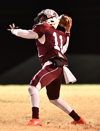 JIM WEBER/Phoenix Correspondent<br /> Eufaula's Nick Jones unleashes a pass against Sequoyah during Friday's 32-0 win over the Indians.