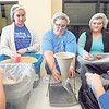 KENTON BROOKS/Muskogee Phoenix<br /> Boulevard Christian's Brittany Hedge, left, along with Jenny Shoemake and Alyssa Shoemake fill bags with rice and other food. The bags will help feed needy people in the Bahamas and Muskogee.
