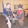 "CATHY SPAULDING/Muskogee Phoenix<br /> Ann Barker Ong gets a birthday serenade from fictitious lawman Rooster Cogburn (portrayed by Clarance Banes) during a Friday reception marking the world premiere of ""Hell on the Border"" held at Three Rivers Museum. The movie depicts the exploits of Territorial lawman Bass Reeves, who served the Muskogee area."