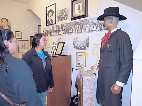 Mary Bear, left, and Julie Frank, both of Sapulpa, look at a Bass Reeves exhibit.