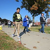 Staff photo by Cathy Spaulding<br /> Oklahoma School for the Blind seventh-grader Julio Valdez follows the Muskogee Civic Center sidewalk with his white cane as volunteer monitors follow him during Thursday's Cane Quest competition.
