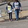 Staff photo by Cathy Spaulding<br /> Oklahoma School for the Blind senior Shaylin Wells, left, crosses a  puddle and a street with Tisha Gossman of Stillwater Public Schools during Cane Quest. The competition, held Thursday, tests skills of orientation and mobility.