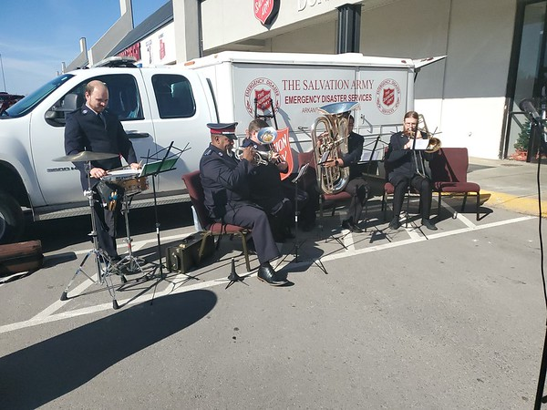 CHESLEY OXENDINE/Muskogee Phoenix<br /> From left to right: Jimmy Cox, Troy Mitchell, Andy Barrington, Jacob Mitchell and Jerry Polk play Christmas Carols at the Salvation Army Kettle Drive Kickoff on Saturday morning.