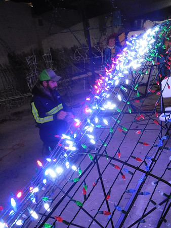 KENTON BROOKS/Muskogee Phoenix<br /> Bobby Harris of the City of Wagoner Water Department checks on the lights to be sure they work on one of the Christmas trees that will be displayed on South Main Street downtown. A new 20-foot tree of lights will be the focus of the display. That tree contains 3,672 red, green, blue and white lights. The city of Wagoner will turn on the lights on Nov. 27 and operate them nightly until after Christmas.