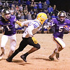 Phoenix special photo by Abigail Washington<br /> Vian's Isaiah Teehee, left, blocks as Bodhi Vann scores a touch down in the 4th quarter of the Wolvderines' win on Friday.