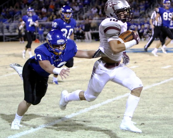 Phoenix special photo by John Hasler<br /> Seqouyah's Shade Watie outruns a Berryhill defender for a 58-yard touchdown in the Indians' 32-30 win on Friday.