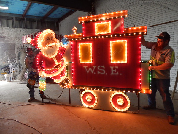 KENTON BROOKS/Muskogee Phoenix<br /> City of Wagoner workers test the lights to see if they work on part of the train that will be lit as part of the town's annual Christmas display.