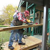 CATHY SPAULDING/Muskogee Phoenix<br /> Howard Harbison planes a board for a ramp he's helping build through the Presbyterian Church of Muskogee's Ramp it Up program. The crew usually works the first Saturday of each month.