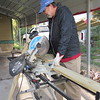 CATHY SPAULDING/Muskogee Phoenix<br /> Jim Nelson runs a circular saw through a board while building a ramp for the Presbyterian Church of Muskogee's Ramp it Up program.