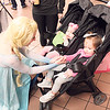 "Special photo by Chesley Oxendine<br /> Carressa Edwards, dressed as Princess Elsa from Disney's ""Frozen,"" greets two children during Saturday's event."