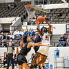 CHRIS CUMMINGS/Special to the Phoenix<br /> Connors State's Jordan Graham puts up a shot between Mid-America Christian's Kelly Elix, front, and Dallas Burko during the Cowboys' 119-61 win at the Muskogee Civic Center on Monday.
