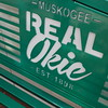 "Staff photo by Mike Elswick<br /> Newly installed downtown Muskogee benches reinforce the ""Real Okie"" slogan."