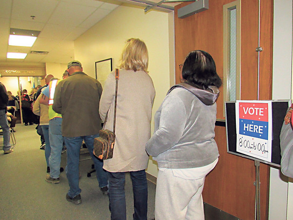 CATHY SPAULDING/Muskogee Phoenix<br /> A line stretches down the hall at the Muskogee County Election Board on Thursday afternoon. Officials with the Muskogee County Election Board said 682 people voted early on Thursday. Early voting continues at 8 a.m. to 6 p.m. today and 9 a.m. to 2 p.m. Saturday.
