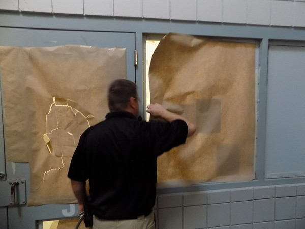 Staff photo by Mike Elswick<br /> Female inmate cells cannot be visible to other areas of a jail, officials said. Wagoner County Jail Administrator Shane Sampson is seen at one of the female inmate cell blocks where windows have been covered with brown paper so they are in compliance with that stipulation.