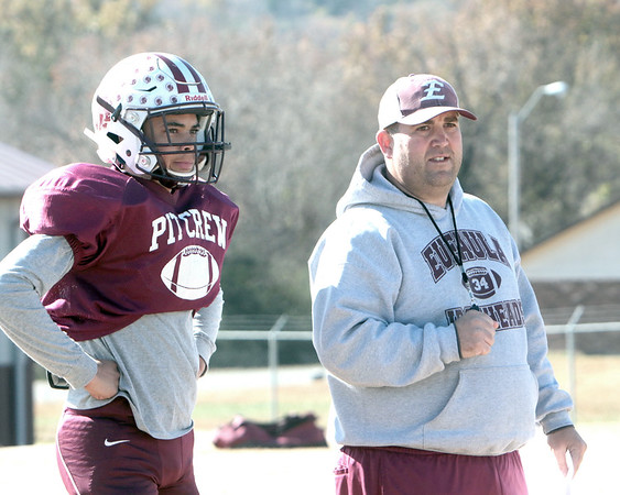 JOHN HASLER/Phoenix Special Photo<br /> Eufaula offensive coordinator Josh Luna, right, looks on at practice earlier this week with quarterback Nick Jones. Luna is a former Ironhead himself who was the Phoenix's Defensive Player of the Year in 2001.