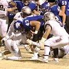 Phoenix special photo by John Hasler<br /> Sequoyah's Jeffrey Vance, bottom, Tyler Barnett, left, and Logan Bush bring down Berryhill's Daniel Rice during the Indians' 32-30 win last Friday in the Class 3A second round. Sequoyah hosts top-ranked Jones at 7 p.m. Friday in the 3A quarterfinals.