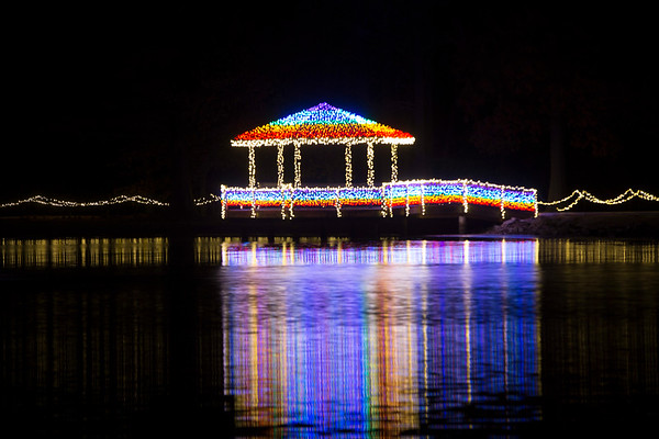 Special photo by Von Castor<br /> A pond at Honor Heights Park is illuminated by Christmas lights. The park opens for visitors at 5:30 p.m. Thursday.