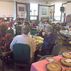 CHESLEY OXENDINE/Muskogee Phoenix<br /> Visitors gather in the Ark of Faith building Thursday for a meal and worship. The meal was free to all comers, and open so that people could be sure to spend their Thanksgiving among others, said Ark of Faith Operations Director Sally S. Weiesnbach.