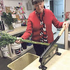 ANDREA CHANCELLOR/Special to the Phoenix<br /> Bebb's owner Kay Kilgore cuts the ends of flower stems.