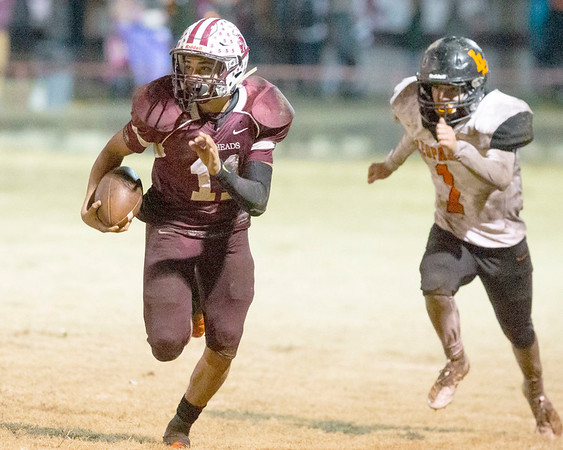 VON CASTOR/Special to the Phoenix<br /> Eufaula's Nick Jones returns an interception in the fourth quarter as Lindsey's Seth Perry gives chase Friday night at Paul Bell Stadium in Eufaula.
