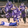 SHANE KEETER/Special to the Phoenix<br /> Vian's Javyn Wright leaps over a Millwood defender for a big gain during Friday's Class 2A second-round playoff game at Vian.
