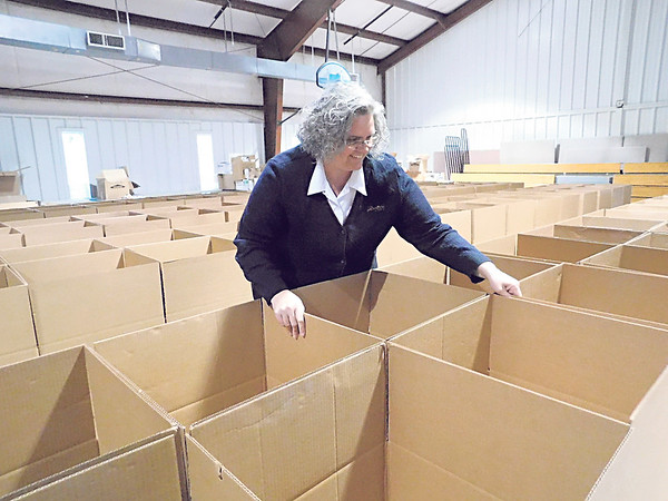 KENTON BROOKS/Muskogee Phoenix<br /> Lt. Teri Smith of the Salvation Army in Muskogee arranges boxes to be used for Angel Tree donations.