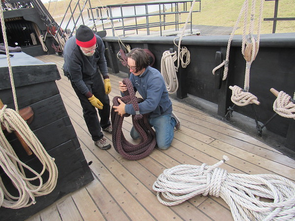Staff photo by Cathy Spaulding<br /> Deck hand Rod Linder, left, and bosun's mate Tom Vaeth wind a shore line rope aboard a replica of the Columbus vessel the Pinta. Replicas of the Pinta and the Nina are at Three Forks Harbor through Dec. 3.