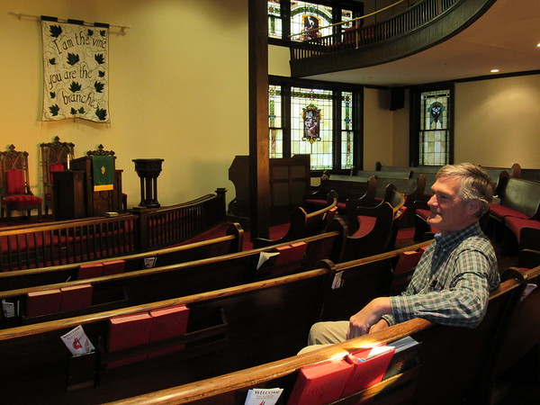 Staff photo by Cathy Spaulding<br /> Long-time First United Methodist Church member Logan Sharpe sits where he used to worship as a child, third row from the back. The church will mark the 100th anniversary of its sanctuary Sunday.