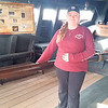 Staff photo by Cathy Spaulding<br /> Nina replica First Mate Kat Wilson shows how a rudder steered the caravel vessel in 1492, when Christopher Columbus sailed on it. Replicas of the Nina and Pinta are at Three Forks Harbor until Dec. 3.