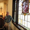 Staff photo by Cathy Spaulding<br /> Logan Sharpe stands by a memorial stained glass window in memory of his family at First United Methodist Church of Checotah.