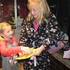 "Staff photo by Cathy Spaulding<br /> Paislee Box, 6, sorts through ""Golden Tickets"" held by her grandmother Kelly Box before seeing ""The Polar Express"" Friday night at the Roxy Theater."