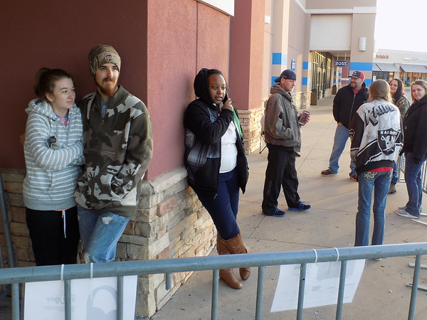 Staff photo by Mike Elswick<br /> Lexi Wheeler and Kyle Ross were at the front of the line at Muskogee's Best Buy Friday morning to take advantage of some Black Friday bargains.