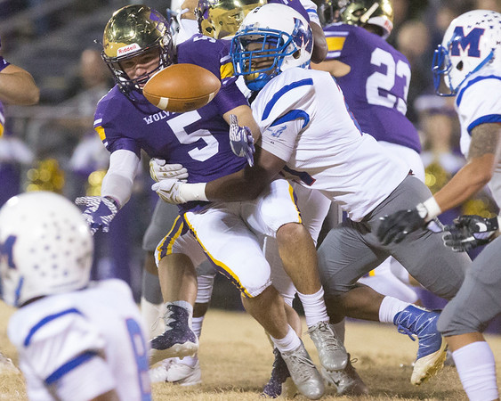 Phoenix special photo by Von Castor<br /> Vian's Bodhi Vann loses control of the ball as he is tackled by Millwood's Nathan Johnson on a kickoff return during the first quarter Friday night in the Class 2A quarterfinal game at Vian. The Wolverines lost 44-0.