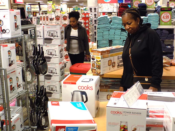 Staff photo by Mike Elswick<br /> Sherell Jackson, left, and Sharla McDaniel were among shoppers arriving at JCPenney in Arrowhead Mall shortly after the store's 8 a.m. opening. They said they had been out shopping Thanksgiving afternoon and reported the early morning Black Friday crowds were a lot thinner than Thursday's crowds.