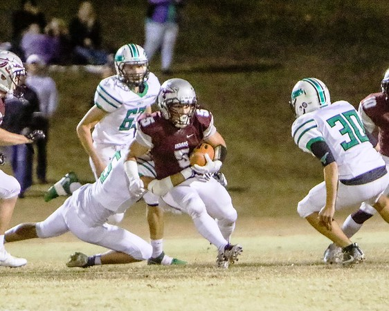 Phoenix special photo by John Hasler<br /> Sequoyah's Logan Bush battles through the Jones defense for yardage during Friday's Class 3A quarterfinal in Tahlequah. The Indians lost 42-6.